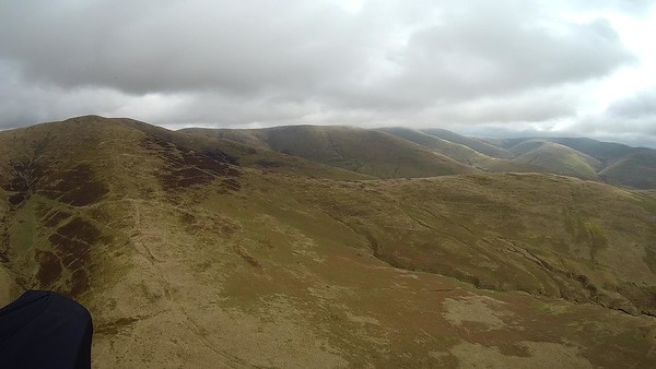 Looking south down the Howgills  with clouds skirting with the tops.