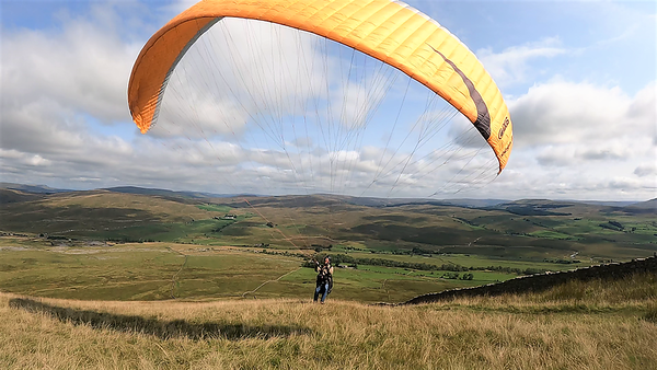 Chris take off on the spur - a good NNE breeze at this stage.