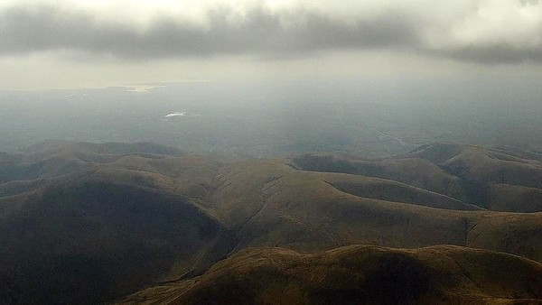 Passing over the Howgills. Very hazy at height .... visibility improved as I headed west.  Cautley and Yarlside below.
