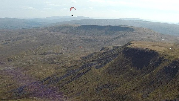 Everyone airborne over Wild Boar. Swarth Fell is the prominent ridge in the background.