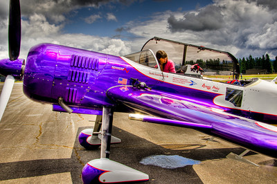 This Russian built Sukhoi SU-29 is a two seat high performance aerobatic monoplane. 360 horse power 9 cylinder radial. Uses compressed air canister to start the engine.