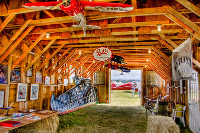 Barnstormer's Barn with a tribute to the Gee Bee. Call Air A-2 visible through the open doorway.