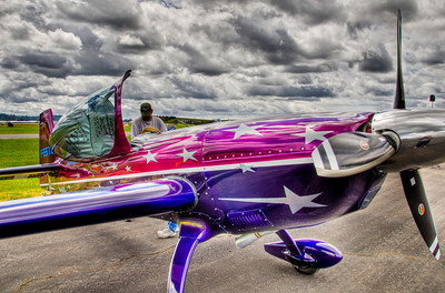 """Vicky Benzing's modified German built Extra 300S is designed and constructed for competition aerobatics. This single seat carbon fiber monoplane is powered by a high performance Lycon built AEIO540 engine with a Hartzell """"Claw"""" propeller."""