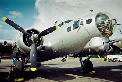 "The Experimental Aircraft Association's B-17G-VE, serial number 44-85740 - nicknamed, Aluminum Overcast, was delivered to the U.S. Army Air Corps on May 18, 1945.  Although delivered too late to see action in World War II, the airplane has an interesting history. Purchased as surplus from the military inventory for a mere $750 in 1946, the airplane has flown more than 1 million miles. It has served as a cargo hauler, an aerial mapping platform and in pest control and forest dusting applications. The airplane's return to its military roots began in 1978, when it was purchased by a group of investors who wished to preserve the heritage of the magnificent B-17. The group, ""B-17s Around the World,"" was headed by Dr. Bill Harrison. Their goal was to return the B-17 to its former glory."