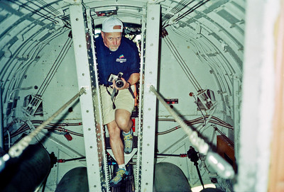 Mike navigates the narrow catwalk through the bomb bay. Note all aluminum body. Boeing was on of the pioneers of stressed-skin design and the B-17 was among the earliest all-metal heavy bombers to enter service.