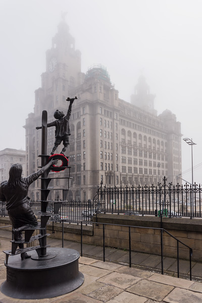 Blitz Monument Sculpture by Tom Murphy and Royal Liver Building, Pier Head, Liverpool in the fog