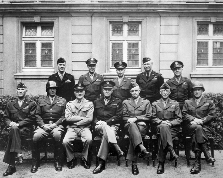 """This is the brass that did it.  Seated are Simpson, Patton (as if you didn't know), Spaatz, Ike himself, Bradley, Hodges and Gerow.  Standing are Stearley, Vandenberg, Smith, Weyland and Nugent.""  Ca. 1945. Army. (OWI)<br /> Exact Date Shot Unknown<br /> NARA FILE #:  208-YE-182<br /> WAR & CONFLICT #:  751"