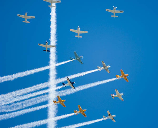Formations cross during the opening 2006 AirVenture show. Phil Weston