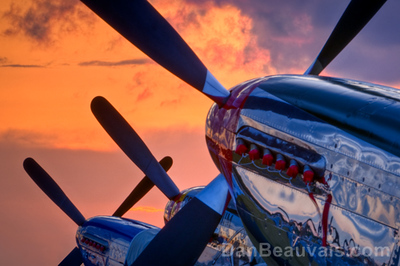 Three World War II era P-51 Mustangs salute a breathtaking sunset at EAA AirVenture in Oshkosh, WI, July 30, 2009