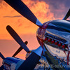 Three World War II era P-51 Mustangs salute a breathtaking sunset at EAA AirVenture in Oshkosh, WI, July 30, 2009
