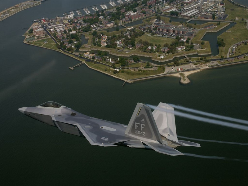 Lt Col James Hecker, the 27th Fighter Squadron commander, flies over historical Fort Monroe in route to deliver the first operational F/A-22 Raptor to its permanent home at Langley Air Force Base, Virginia May 12, 2005.  Tail number 3042 marks the first of 26 Raptors to be delivered to the 27th Fighter Squadron.<br /> (USAF Photo by TSgt Ben Bloker)