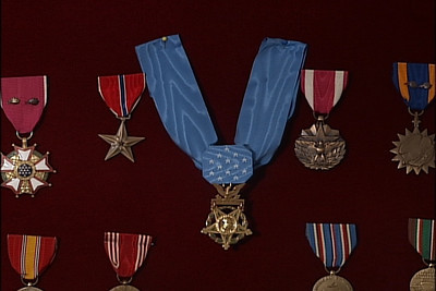 "This 1944 Medal of Honor citation, listed with the National Medal of Honor Society, is for Second Lieutenant Van T. Barfoot, 157th Infantry, 45th Infantry:  ""For conspicuous gallantry and intrepidity at the risk of life above and beyond the call of duty on 23 May 1944, near Carano , Italy . With his platoon heavily engaged during an assault against forces well entrenched on commanding ground, 2d Lt. Barfoot moved off alone upon the enemy left flank. He crawled to the proximity of 1 machinegun nest and made a direct hit on it with a hand grenade, killing 2 and wounding 3 Germans. He continued along the German defense line to another machinegun emplacement, and with his tommygun killed 2 and captured 3 soldiers. Members of another enemy machinegun crew then abandoned their position and gave themselves up to Sgt. Barfoot. Leaving the prisoners for his support squad to pick up, he proceeded to mop up positions in the immediate area, capturing more prisoners and bringing his total count to 17. Later that day, after he had reorganized his men and consolidated the newly captured ground, the enemy launched a fierce armored counterattack directly at his platoon positions. Securing a bazooka, Sgt. Barfoot took up an exposed position directly in front of 3 advancing Mark VI tanks. From a distance of 75 yards his first shot destroyed the track of the leading tank, effectively disabling it, while the other 2 changed direction toward the flank. As the crew of the disabled tank dismounted, Sgt. Barfoot killed 3 of them with his tommygun. He continued onward into enemy terrain and destroyed a recently abandoned German fieldpiece with a demolition charge placed in the breech. While returning to his platoon position, Sgt. Barfoot, though greatly fatigued by his Herculean efforts, assisted 2 of his seriously wounded men 1,700 yards to a position of safety. Sgt. Barfoot's extraordinary heroism, demonstration of magnificent valor, and aggressive determination in the face of point blank fire are a perpetual inspiration to his fellow soldiers."""