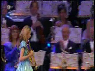 The conductor of the orchestra is Andre Rieu from Austria. The young lady, her trumpet and her rendition of  TAPS makes your hair stand on end.    You may never have heard taps played in its entirety. This is an opportunity you won't want to miss and I guarantee you are not likely to forget.    http://www.youtube.com/watch?v=9ETrr-XHBjE   This rare vocal interpretation of the lyrics to one of the most profound instrumental pieces frequently performed at military ceremonies -- recording artist Mel Carter brings the message home loud and clear. Dedicated to the men and women of our armed forces: past, present, future.   http://www.youtube.com/watch?v=Ccduz30yvd0