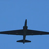 "Minot AFB Norther Neighbors Day Air Show<br /> <br /> <br /> The Lockheed U-2, nicknamed ""Dragon Lady"", is a single-engine, very high-altitude surveillance aircraft flown by the United States Air Force and previously flown by the Central Intelligence Agency. It provides day and night, very high-altitude (70,000 feet/21,000 meters), all-weather surveillance. The aircraft is also used for electronic sensor research and development, satellite calibration, and satellite data validation.<br /> The large wingspan and resulting glider-like characteristics of the U-2 make it highly sensitive to crosswinds which, together with its tendency to float over the runway, makes the U-2 notoriously difficult to land. This results in a required chase car (usually a ""souped-up"" performance model including a Ford Mustang SSP, a Chevrolet Camaro B4C, and most recently a Pontiac GTO) and assistant who ""talks"" the pilot down by calling off the declining height of the aircraft in feet as it decreases air speed in order to overcome the cushion of air provided by the high-lift wings in ground effect."