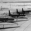 "In the early 1950s, with Cold War tensions on the rise, the U.S. military desired better strategic reconnaissance to help determine Soviet capabilities and intentions. The existing reconnaissance aircraft, primarily bombers converted for reconnaissance duty, were vulnerable to anti-aircraft artillery, missiles, and fighters. It was thought an aircraft that could fly at 70,000 feet (21,000 m) would be beyond the reach of Soviet fighters, missiles, and even radar.[2] This would allow overflights (knowingly violating Soviet airspace) to take aerial photographs.<br /> Original U-2A at USAF Museum<br /> <br /> Under the code name ""Bald Eagle"", the Air Force gave contracts[3] to Bell Aircraft, Martin Aircraft, and Fairchild Engine and Airplane to develop proposals for the new reconnaissance aircraft. Officials at Lockheed Aircraft Corporation heard about the project and asked aeronautical engineer Clarence ""Kelly"" Johnson to come up with a design. Johnson was a brilliant designer, responsible for the P-38, and the P-80. He was also known for completing projects ahead of schedule, working in a separate division of the company jokingly called the Skunk Works.[citation needed]<br /> <br /> Johnson's design, called the CL-282, married long glider-like wings to the fuselage of another of his designs, the Lockheed F-104 Starfighter. To save weight, his initial design did not have conventional landing gear, taking off from a dolly and landing on skids. The design was rejected by the Air Force, but caught the attention of several civilians on the review panel, notably Edwin Land, the father of instant photography. Land proposed to CIA director Allen Dulles that his agency should fund and operate this aircraft. After a meeting with President Eisenhower, Lockheed received a $22.5 million contract for the first 20 aircraft. It was renamed the U-2, with the ""U"" referring to the deliberately vague designation ""utility"". The CIA assigned the cryptonym ""AQUATONE"" to the project, with the Air Force using the name ""OILSTONE"" for their support to the CIA.[4]<br /> <br /> The first flight occurred at the Groom Lake test site (Area 51) on 1 August 1955, during what was only intended to be a high-speed taxi run. The sailplane-like wings were so efficient that the aircraft jumped into the air at 70 knots (130 km/h).[5]<br /> U-2 camera on display at the National Air and Space Museum<br /> <br /> James Baker developed the optics for a large-format camera to be used in the U-2 while working for Perkin-Elmer. These new cameras had a resolution of 2.5 feet (76 cm) from an altitude of 60,000 feet (18,000 m).[5] Balancing is so critical on the U-2 that the camera had to use a split film, with reels on one side feeding forward while those on the other side feed backward, thus maintaining a balanced weight distribution through the whole flight.[citation needed]<br /> <br /> When the first overflights of the Soviet Union were tracked by radar, the CIA initiated Project RAINBOW to reduce the U-2's radar cross section. This effort ultimately proved unsuccessful, and work began on a follow-on aircraft, which resulted in the Lockheed A-12 Blackbird.[citation needed]<br /> <br /> Manufacturing was restarted in the 1980s to produce TR-1, an updated and modernized design of the U-2."