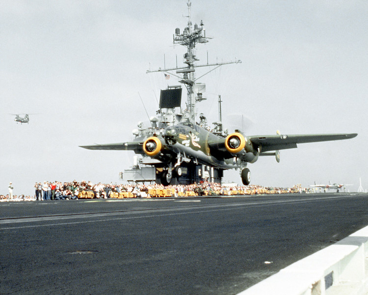 "The restored World War II B-25 Mitchell bomber aircraft ""Heavenly Body"" takes off from the deck of the aircraft carrier USS RANGER (CV-61).  It and another B-25 are being launched in a re-enactment of ""Doolittle's Raid"" of April 18, 1942, during which 16 B-25's were launched from the aircraft carrier USS HORNET (CV-8) in the first attack on the Japanese mainland."