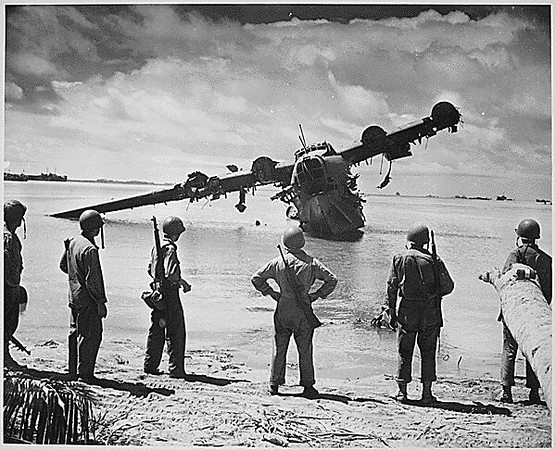Japanese Kawanishi H8K seaplane after strafing. Kwajalein