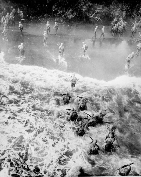 Marines disembark LST at Tinian Island .