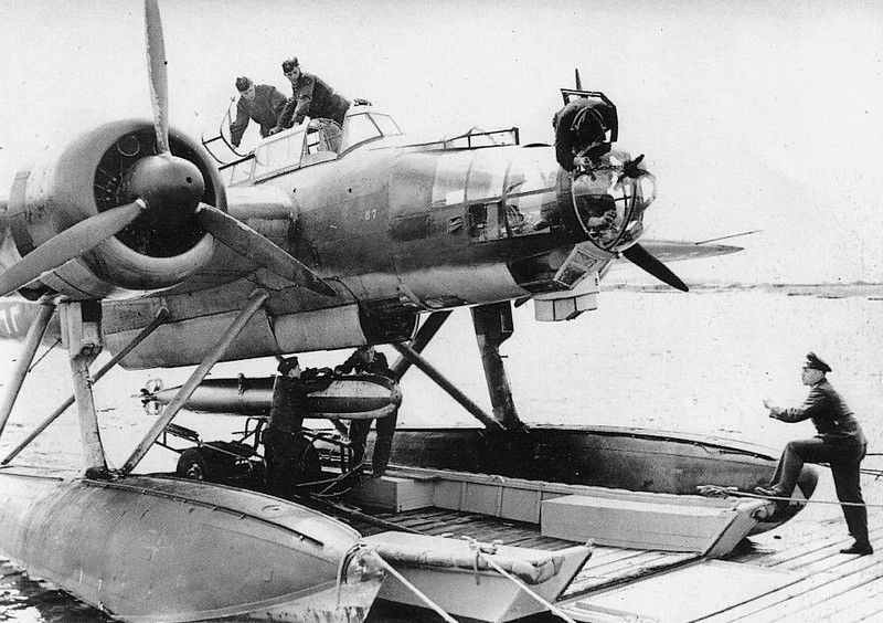 Heinkel (HE 115)  loading a torpedo. This is one HUGE bomber ... and it's on pontoons!!!!