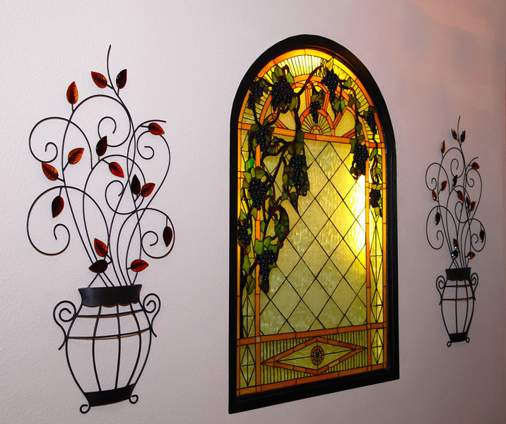 Adding this stained glass to our entry way was a lot of work, but now that it is completed, it was worth it.  A lot of blood, sweat and tears to get it just right!!  The black metal frame really makes it look great.