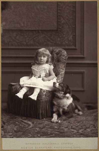 Studio portrait of a girl with her dog