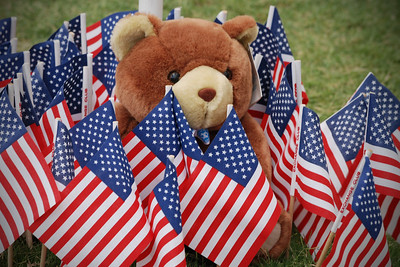 Each child's flag has a teddy bear.