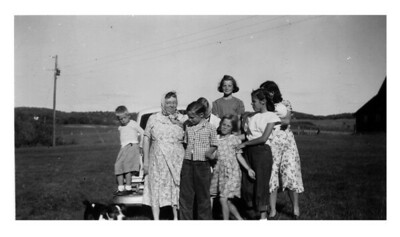 Grandma Ida, Jimmy, Arlene, Sharon, Janice, Ilah, Ida, Esther McCready (with babe  in arms) at Harriet & Ed Benzinger's farm, summer 1949.