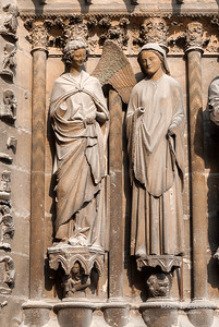 "One of the iconic ""smiling angels"" on the west facade, representing the elegant Remois style (c. 1245-55)"