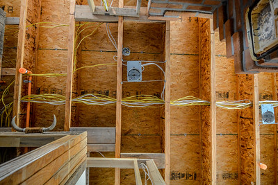 Cables emerge from the utility room on the left to feed most of the house's 20-plus electric circuits.