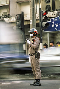 Thai Traffic Cop with Face Mask