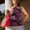 With a pink handbag