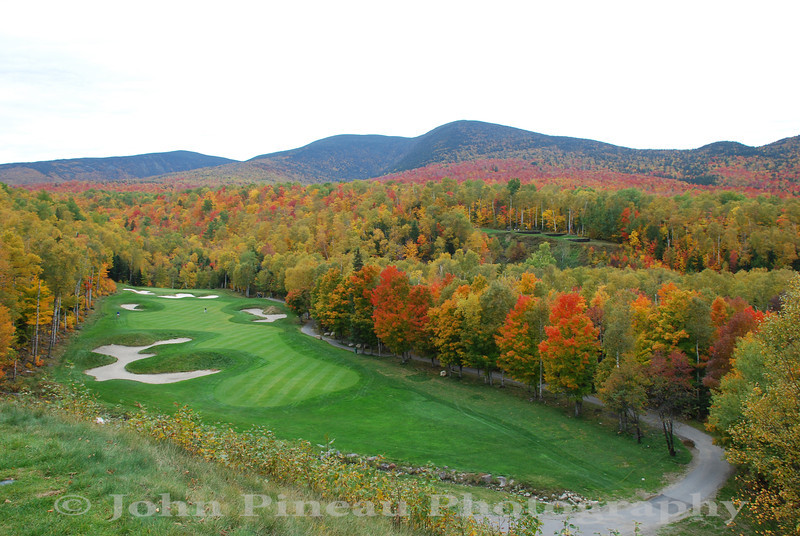 Sugarloaf USA - 10th Hole - tee box 120 feet above the fairway - the three tiered 11th hole tee box is on the right