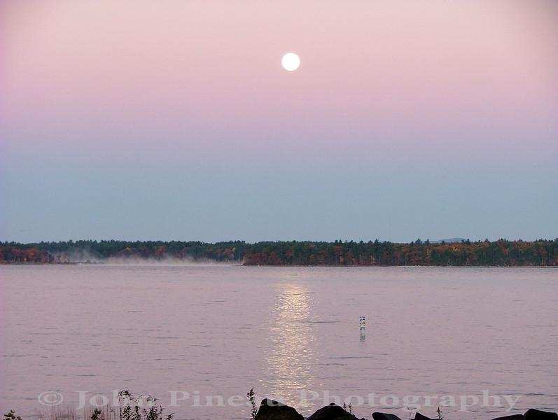 Moon setting over Sebago Lake on a crisp fall morning<br /> FO_0017-DSCF5343