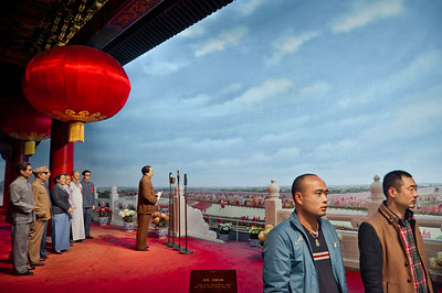 Shaoshan Mao Memorial Museum, Shaoshan, Hunan Province.  Museum Visitors pose before the diorama of Mao Zedong declaring the founding of the Peoples Republic of China, October 1, 1949.
