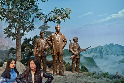 Shaoshan Mao Memorial Museum, Shaoshan, Hunan Province Museum visitors pose in front of bronze represenation of Mao and Long Marchers.