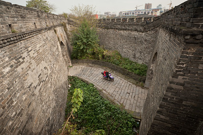 Jingzhou, Hubei Province. The formerly defensive Small North Gate vestibule of the ancient city wall of Jingzhou is now easily permeable. City fortification began in the Spring and Autumn period when Ying, present-day Jingzhou, was capital of the Chu state. The wall were last rebuilt in the 17th century.