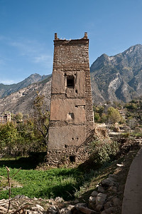 Zhonglu, Danba County, Sichuan Province.  A smaller scale Jiarong Tibetan watchtower exhibits remnants of  a previously adjoining structure. While remaining centuries-old watchtowers, which reach heights of up to 60m, are now conserved to promote heritage and tourism, stone from derelict structures is routinely re-purposed into the new construction of the region.