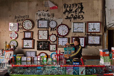 Zigong, Sichuan Province. Market wares line the Futaishan pedestrian tunnel which traverses beneath the ridgeline along the Fuxi River.