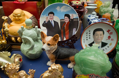 Among collectibles at a Shiyan market, Hubei Province, decorative plates feature the image of President Xi Jinping--on one with his wife Peng Liyuan and on another with characters中国梦(Chinese Dream)  and Deng Xiaoping's slogan, 空谈误国,实干兴邦 (idle chatter impedes the nation, diligence advances the state.)