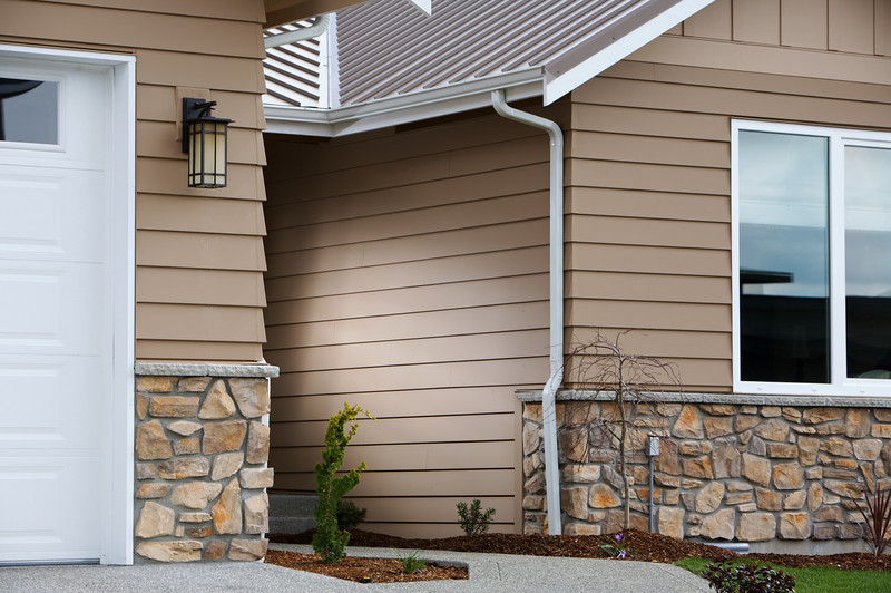 Hidden strobe to add depth to an otherwise unremarkable assignment  (brown siding product photos)