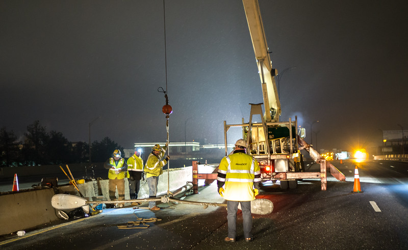 Work Crews Chopping Down Hazardous Light Poles.