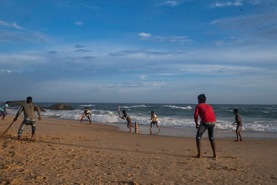 Children from fishermen community playing cricket on the beach in Colachel which is one of the most popular sport in India.