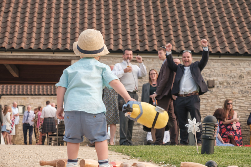 Toddler crashes skittles with Minion toy at wedding