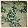JF-103_GIs break for lunch during training at Fort Hood. May be Gene Molnar holding canteen cup.