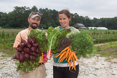 Organic farm owners hold produce
