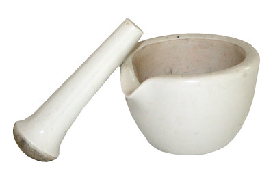 white ceramic mortar and pestle