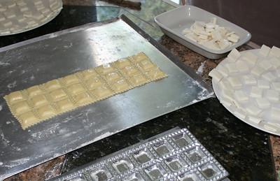 making homemade ravioli in a kitchen