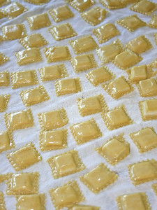 making homemade ravioli in a kitchen