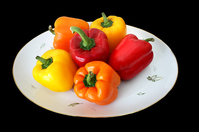 Isolated Colored Sweet Peppers on a Plate