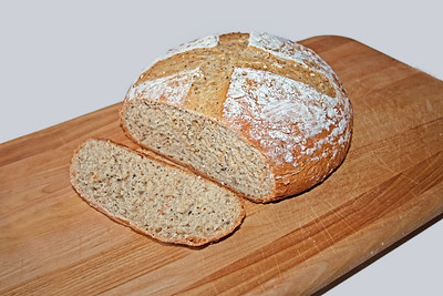 an artisan loaf of multi-seed whole wheat bread